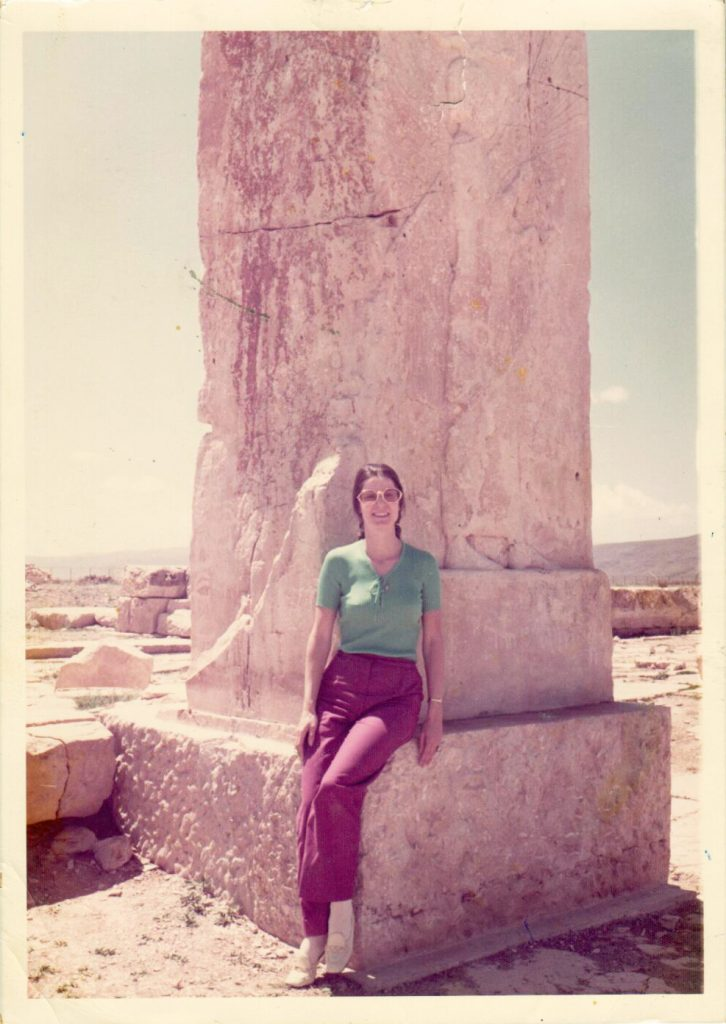 Posing in front of a column, 36 ft tall