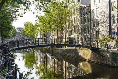 old-gabled-buildings-reflecting-in-a-canal-amsterdam-north-holland-the-netherlands-europe-RHPLF12309